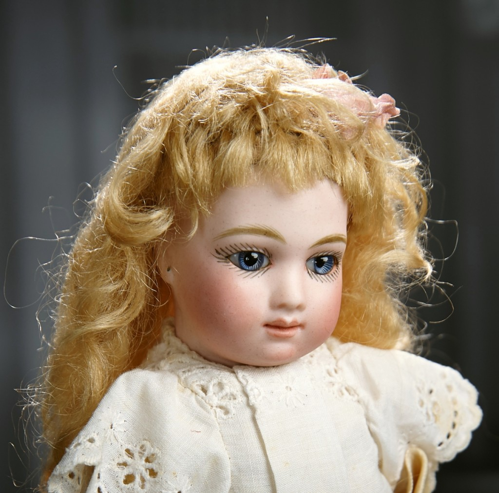 A rare 9-inch and stunningly beautiful petite French bisque bebe A.T., by Andre Thuillier, circa 1882, sold to a gallery bidder at $66,600, far above its $8/11,000 estimate, which caused loud clapping from the inhouse bidders.