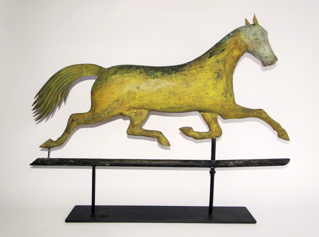 A running horse weathervane by A.L. Jewell brought the second highest price of the day at $4,025, circa 1850 and 32 inches long.