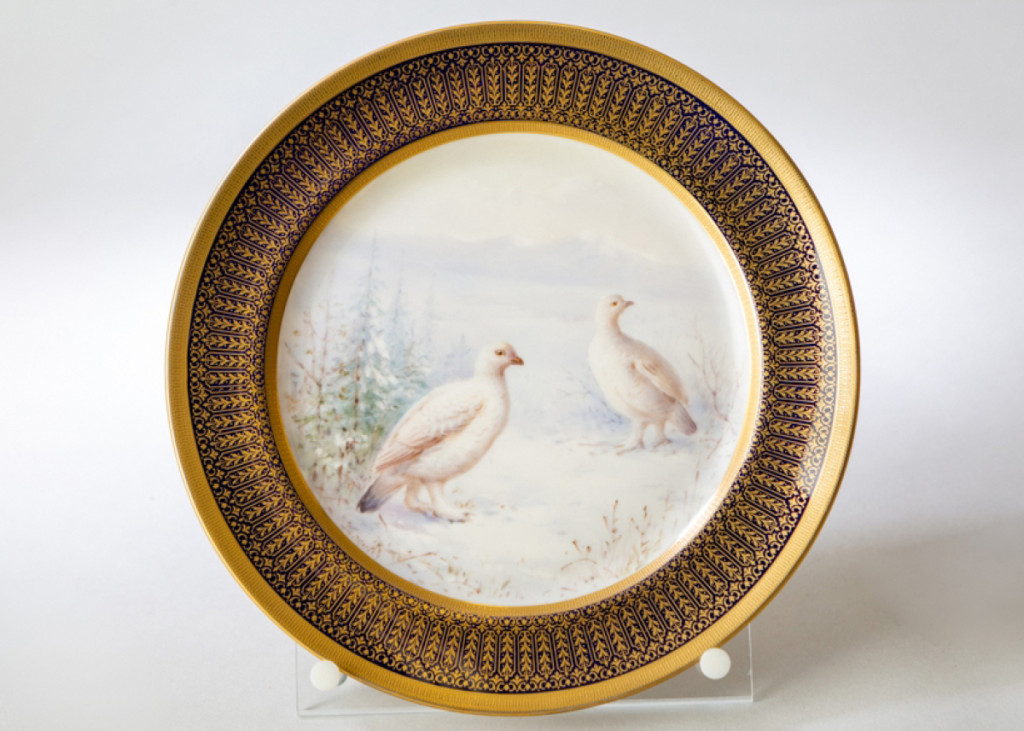 Ptarmigan turn white in winter in order to blend in with their snowy surroundings and hide from predators. They are the only bird that molt into all-white feathers every year. This porcelain plaque by William H. Morley features hand-painted ptarmigan in full winter plumage. Plaque with Ptarmigan, Lenox, Inc., decorated by William H. Morley (1869-1934), Trenton, N.J., circa 1910. Porcelain. Collection of New Jersey State Museum. Gift of Brown-Forman Corporation.