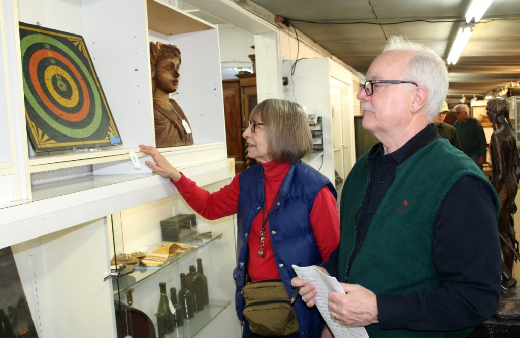 Joanne and Brian Kaley, proprietors of Cobblestone Antiques in Pleasant Valley, N.Y., were looking at items during the morning preview before the sale started on New Year's Day.