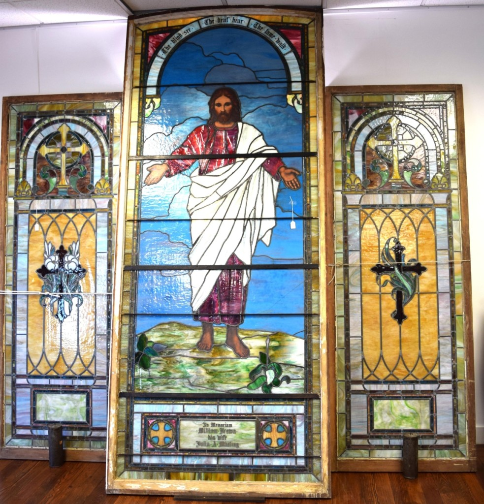 A large circa 1890 religious-themed stained glass window with side panels sold for $3,660.