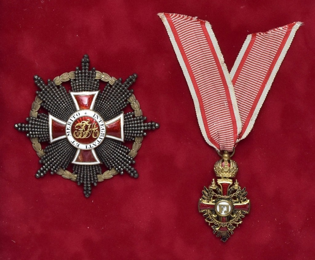 Order of Franz Joseph Knights Cross, 2-inch-long gilt bronze with enamel with original box and Order of Leopold Grand Cross with red and white enamel, 3¼-inch-long Austrian medals, both now framed in a shadow box sold at $9,000.