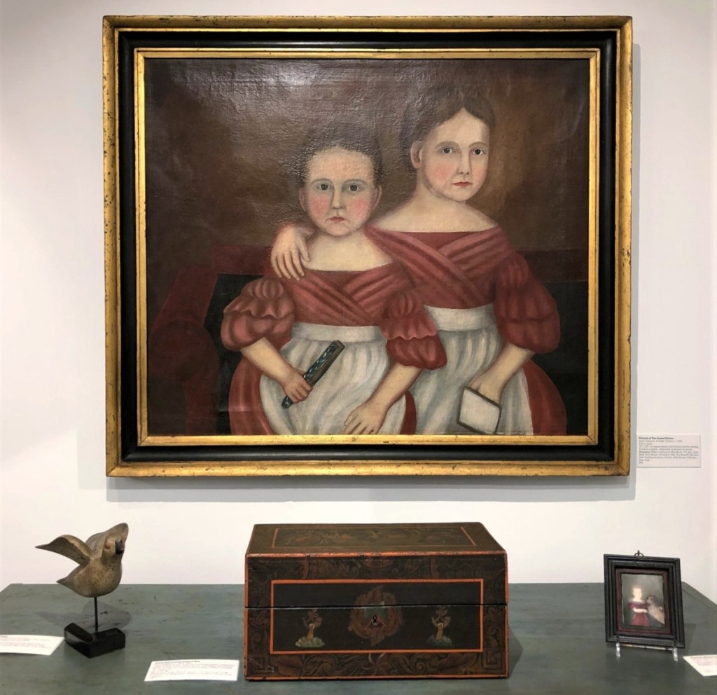This arresting double portrait of two sisters is probably from Vermont and dates to about 1830. An old photograph shows it in the booth of Vermont dealer Hillary Underwood. It later belonged to Claude and Alvan Bisnoff. With it are a New England paint-decorated lidded box of circa 1825-40 and a circa 1820 portrait miniature of a boy with his dog.