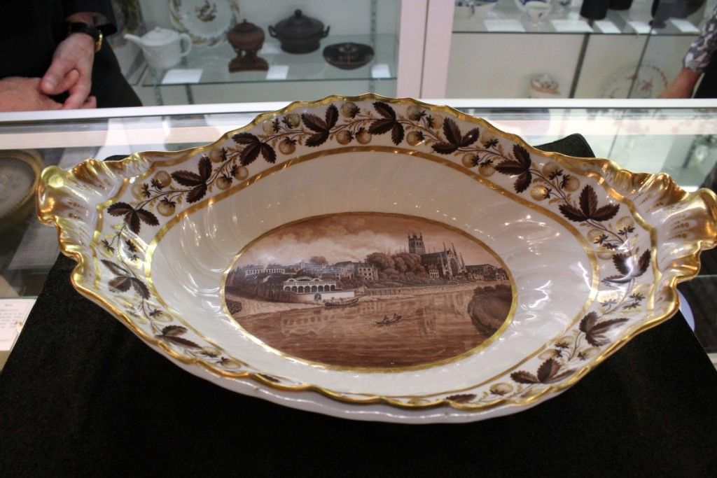 This large dish, called a comport, Worcester, circa 1800, is illustrated with a view of the Flight & Barr Porcelain Factory. Although a transfer print, the hand painted platter is rare, according to Etruria Antiques Gallery, Melbourne, Australia.