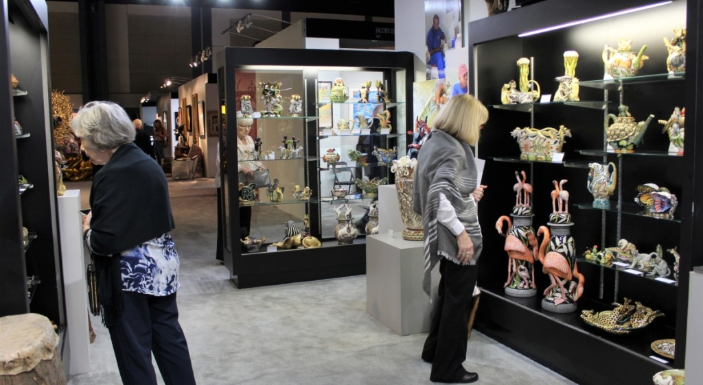 Showgoers admiring the selection of South African Ardmore Ceramic art with Pacoe Gallery, North Miami, Fla.