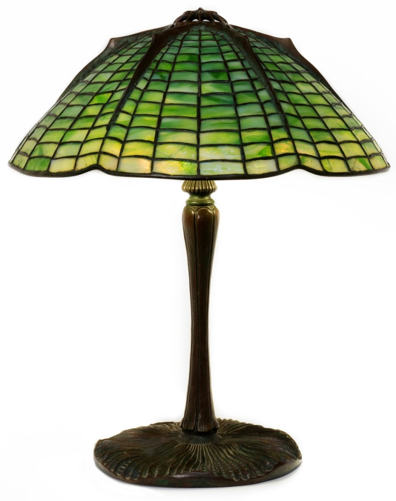 "This Tiffany Studios New York, ""Spider"" table lamp, circa 1900-15, brought $48,000. It stood 15 inches high on a mushroom base and had an 18½-inch diameter shade."