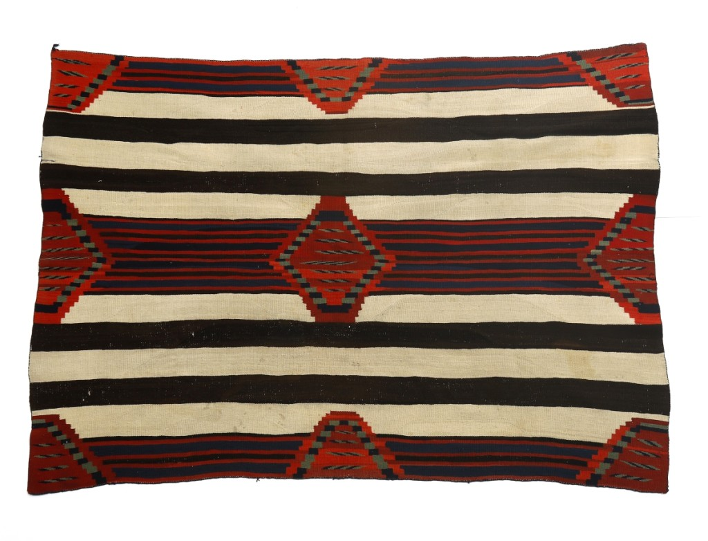 Considered to be among the best Navajo textiles, mostly due to the skill of the Navajo women weavers, third phase chief's blankets are highly desirable, as was this circa 1865-75 example that took $30,000. Of handspun wool, natural and aniline dyes and measuring 54 by 76½ inches, the late Classic period piece featured cream, dark brown, indigo blue and green, red and bright red.