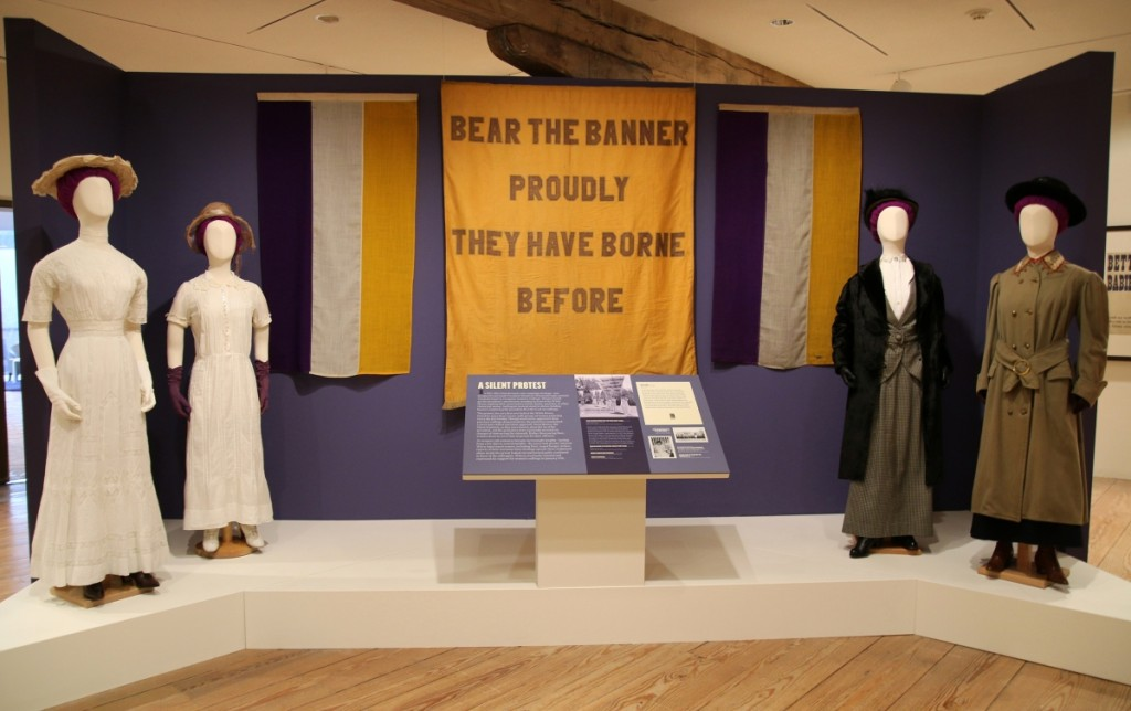 "Exhibition vignette with the ""Bear the Banner Proudly They Have Borne Before"" banner, circa 1913-1920. National Woman's Party. Belmont-Paul Women's Equality National Monument, Washington, DC."
