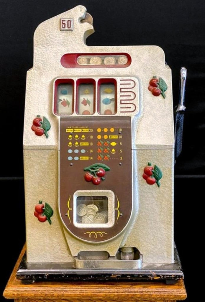 """The top lot of the day was this Mills 50-cent """"Black Cherry"""" slot machine that sold for $1,320. The case was cast metal with hammer-tone surface and raised cherries."""