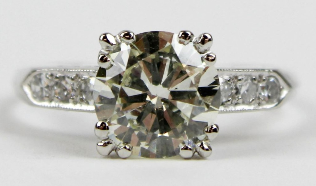 A 1.82-carat solitaire diamond and platinum ring brought $5,100. The stone was SI2 color O with three small round cut diamonds down each side.
