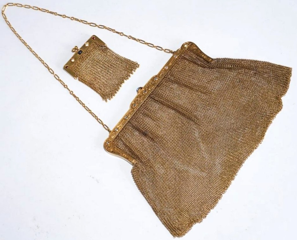 A set of two mesh purses with 14K gold clasps, circa 1900, set with diamonds and sapphires, sold at $5,280.