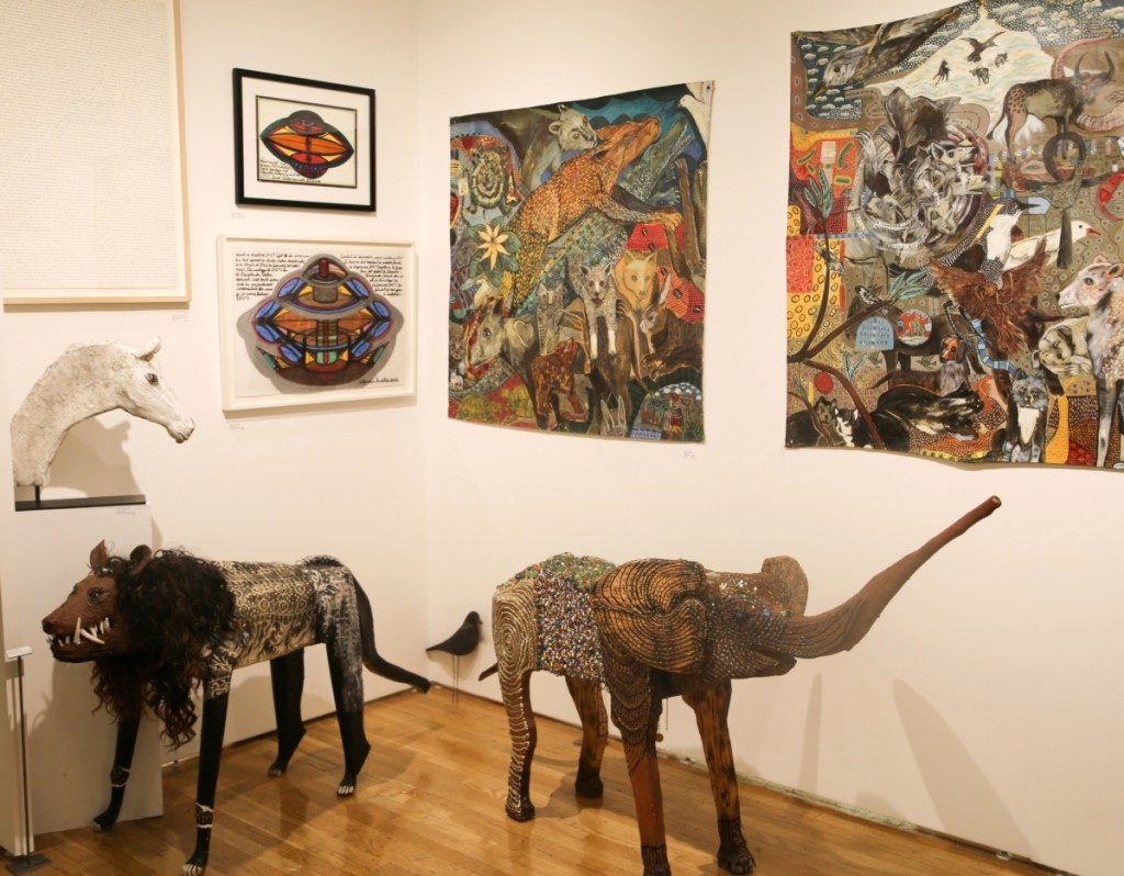 Works from Ionel Talpazan and O.L. Samuels are seen in American Primitive's booth from the 2017 Outsider Art Fair.