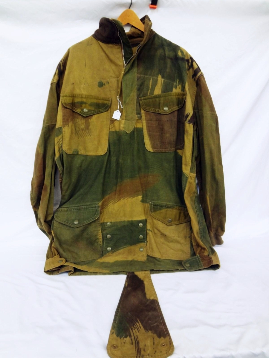 Bringing the second highest price in the sale — $2,142 from a private collector — was this World War II British Airborne smock, circa 1942. Tharp said it was from a private collector who collects military antiques; it is going into another private collection. Tharp said it was of an unusually large size, which was the reason it generated so much interest ($200/300).