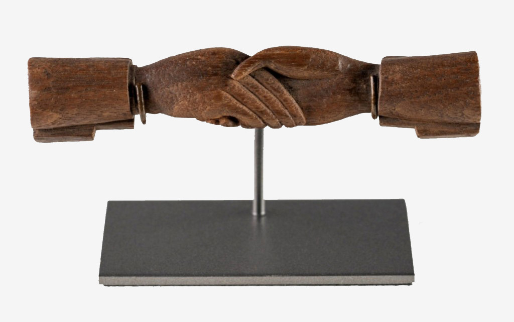 """There was no other item in the show that embodied its spirit more than this object sold by Olde Hope Antiques, Inc., New Hope, Penn., and New York City. A carved walnut love token of two clasped hands, 4½ inches long, with carved lettering on the cuffs """"Remember me, Truly Thine."""""""