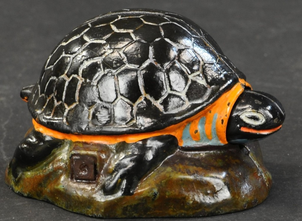 From the Bob Weiss collection came this beautifully painted Kilgore Turtle mechanical bank that took $24,000. The example was in pristine condition. When a coin is dropped into the shell, the turtle's head pokes out.