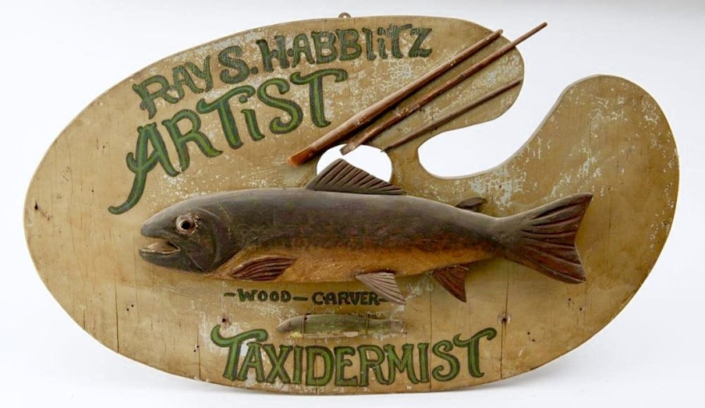 One of many sales with Jewett-Berdan was this 1920 folk art trade sign made by — and for — Ray S. Habblitz, who was an artist, wood carver and taxidermist. The unrestored sign measured 34 inches long by 20 inches tall and had been in a Massachusetts collection. Newcastle, Maine.