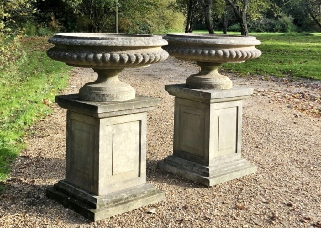 Judy and James Milne, At Home Antiques and Design, Kingston, N.Y., offered this pair of cast stone tazza urns on their original pedestals, circa 1950 from Sussex, UK. They measure 30 inches diameter by 40½ inches high.
