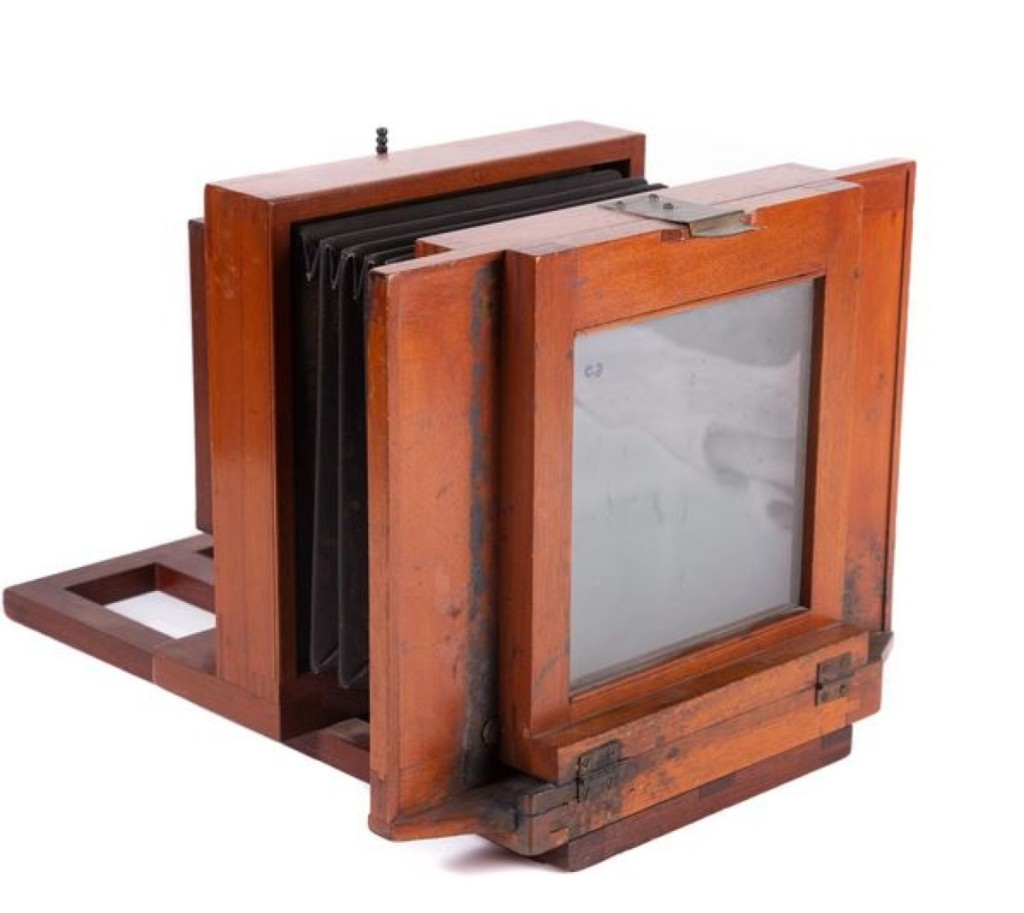 Opfer said that this Simon Wing four-tube camera could take four images at one time. It had an intact bellows and was made of mahogany. The example led the camera category as it sold for $2,091.