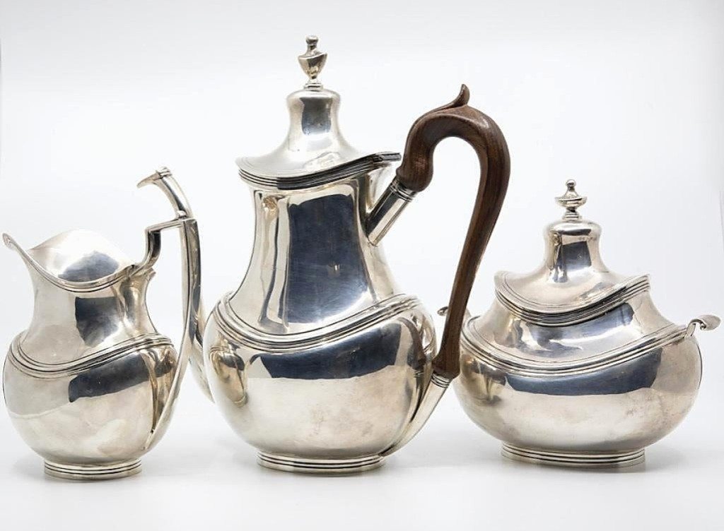 """The second highest price of the sale — $1,680 — was achieved by this sterling silver Art Deco tea set with rosewood handles that had been made in Lisbon and was marked """"Sarmento."""" A private collector won the lot after protracted bidding."""
