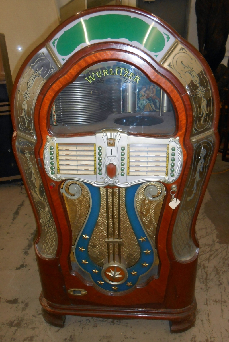 """Mae West said """"When I'm good, I'm very good. When I'm bad, I'm better."""" This Wurlitzer """"Mae West"""" jukebox was in """"hard to find"""" unrestored condition, played two sizes of records and had an extra mechanism. A private collector took it to $4,887, the second highest price in the sale ($2/4,000)."""