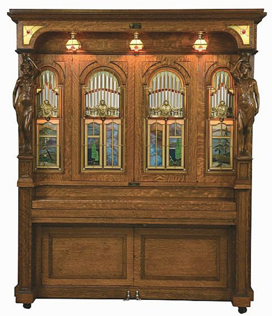 The top lot of the sale was this Style H orchestrion by the J.P. Seeburg Piano Company, which sold for $83,025. It was one of the largest models the company made and one of the most ornate. This example features stained glass and carved figures of Beauty and Strength to the columns, all housed within a tiger-striped oak cabinet. The orchestrion played at the Crystal Saloon in Virginia City, Nevada, for the first half of its life. Seeburg manufactured the orchestrion until the late 1920s.