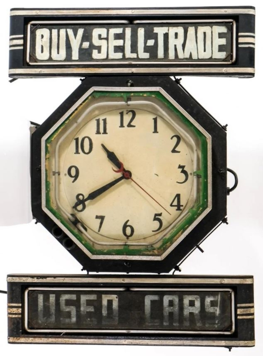 The sale's top lot was found in this used car neon clock trade sign that sold for $3,198. It had original black paint and green neon.
