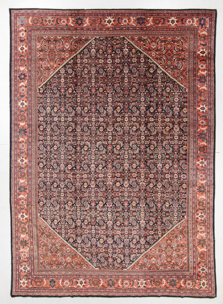 """Top lot in the sale was this Persian Sultanabad rug from the early Twentieth Century, which commanded $6,250. Of wool pile with cotton warp and weft, it weighed in at 95 pounds and measured 12 feet 4 inches by 17 feet 2 inches. The firm's George Jevremovic said it was """"a very good antique rug in great condition, especially considering its very large size."""""""