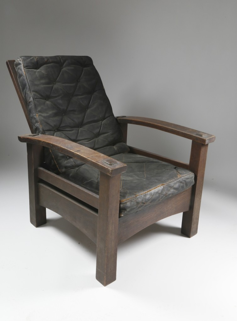 From the estate of Nantucket resident and conservationist Linda Loring, this Gustav Stickley reverse tapered bow-arm Morris chair, circa 1901, in oak with original black leather upholstered seat back and cushion, was bid to $48,800.