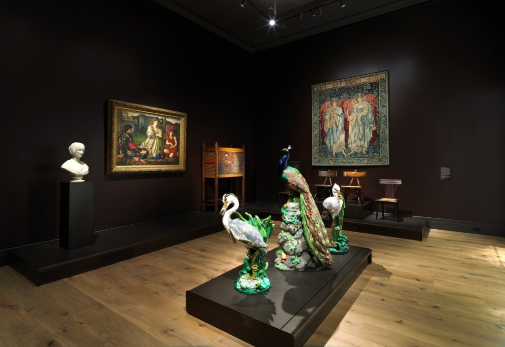 "Another view of the Nineteenth Century gallery. Against the left wall is a marble bust of Mary Shelley by Camillo Pistrucci (1811-1854); Sir Edward Burne-Jones's painting ""The Love Song,"" 1868-77; and an 1861 cabinet designed by Philip Webb (1831-1915), manufactured by Morris, Marshall, Faulkner & Co., and decorated by Burne-Jones with backgammon players. The Minton majolica figures in the foreground are on loan from Linda Horn. Right are chairs designed by Edward Welby Pugin (1834-1875) and a tapestry manufactured by Morris & Company Weaving workshop at Merton Abbey Tapestry Works in 1898.                                 —Joseph Coscia photo"