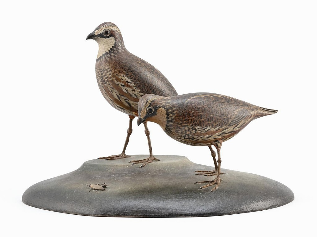 From the Mr & Mrs Kenneth DeLong collection of bird carvings, a rare pair of A. Elmer Crowell decorative life-size bobwhite quail, circa 1938, went out at $25,000. Details include one quail looking at a carved fly on the base.