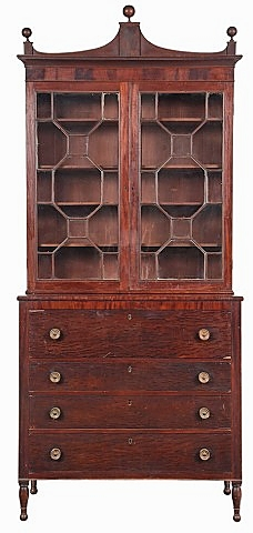 This circa 1815 Federal desk and bookcase with sophisticated form and construction, that together suggested an urban origin, had not been known before it came to market at Brunk Auctions. It descended in the family of its original owner, Benjamin Leigh (1761-1830) of Augusta, Ga., and was accompanied by an engraved silver pocket watch and two embossed leather pocketbooks, one of which contained three Confederate notes. Competition on the lot came from some of Georgia's top collectors, all bidding by phone. It sold for $56,580 ($12/18,000).