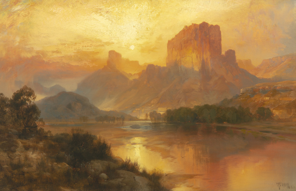 """Thomas Moran's (1837-1926) """"Green River, Wyoming"""" was the sale's top lot at $1,638,000. The scene, with its golden sky and towering butte, is an iconic one for Moran and always very desirable among collectors of Western art. Moran visited the scene on his first trip out West in 1871 and would return to sketch it again in 1879. This work was made in his studio in 1883."""
