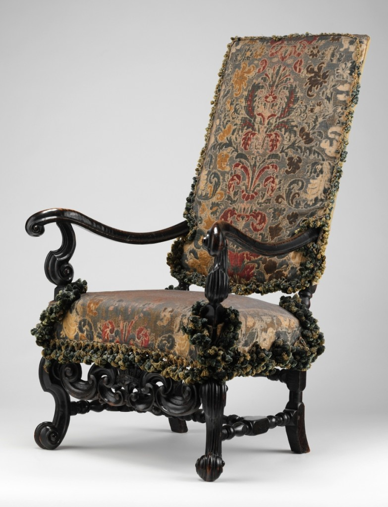 Armchair, one of a pair attributed to Thomas Roberts (active 1685-1714), circa 1700. Ebonized beechwood, original Genoese velvet covers; 48 by 28 by 32 inches. Purchase, Gift of Irwin Untermyer, by exchange, and bequests of Bernard M. Baruch, Ruth Mabee Lachman Greenleaf, and Irwin Untermyer, by exchange, 1998.