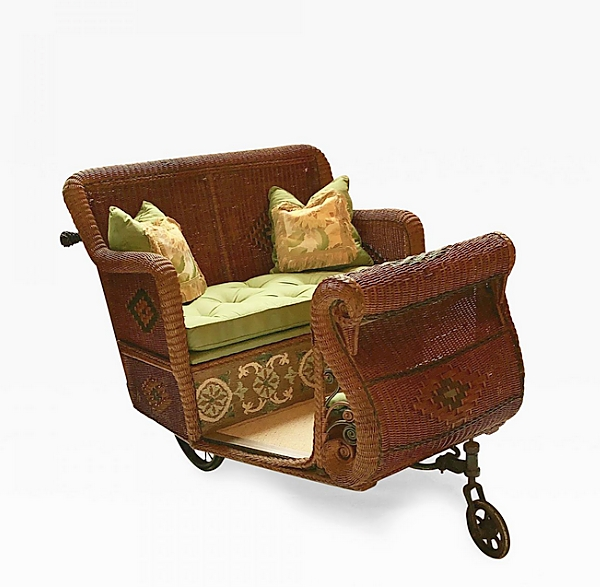Who needs a ride? Selling from Antique American Wicker, Nashua, N.H., was this wicker estate cart circa 1900-19. It featured a natural finish with colored trim work, stylized diamond designs and bowed Swan front with original wheels.