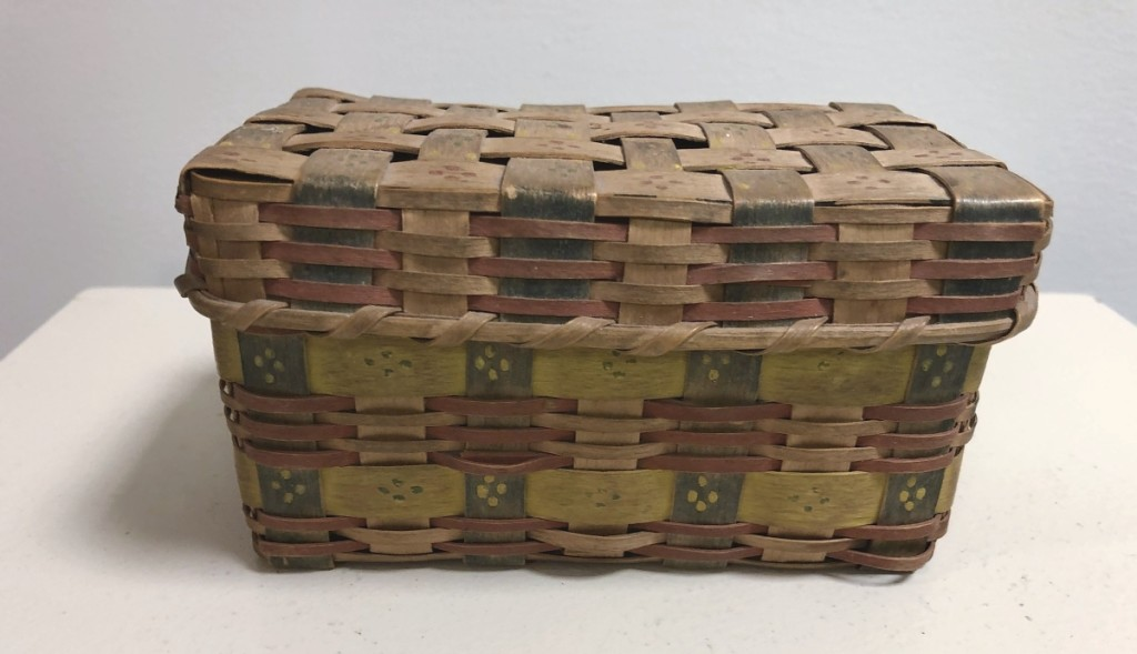 A rare miniature (3 by 5 inches) basket, crafted and paint-decorated circa 1830 by Northeastern Native Americans was in mint condition and sold by Pat & Rich Garthoeffner Art & Antiques.