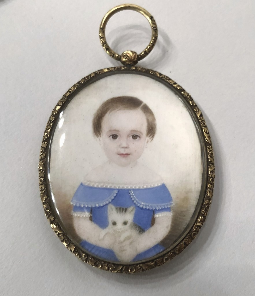 Hercules Pappachristos sold these Wilson family portrait miniatures from Boston, Nineteenth Century. Shown were a young husband and wife and their child in a blue dress holding a kitten. They were purchased directly from the family.