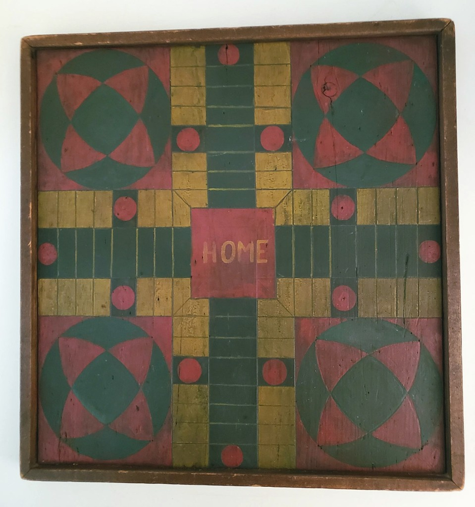 Tom and Beverly Longacre parted with this wooden double-sided game board that had a multicolored Parcheesi game on one side and a red and black checkers game on the reverse. Circa early Twentieth Century, it measured 18 by 17½ inches.
