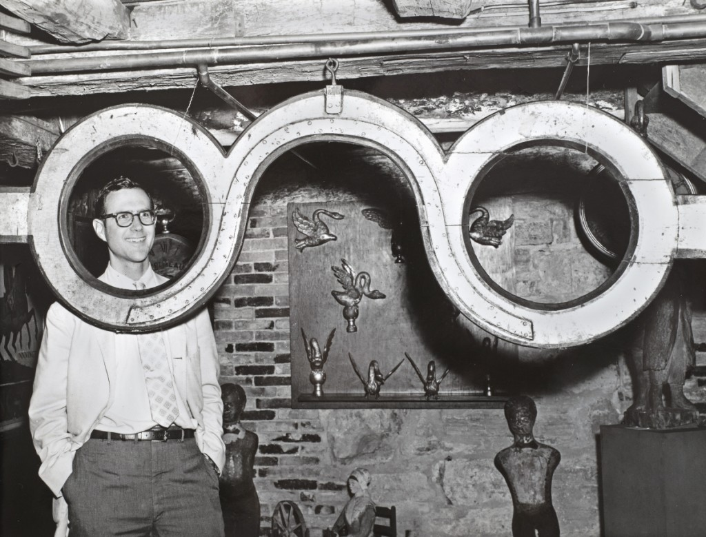 """""""John Wilmerding with Spectacle trade sign, July 10, 1968"""" by Einars J. Mengis.   Collection of Shelburne Museum Archives."""