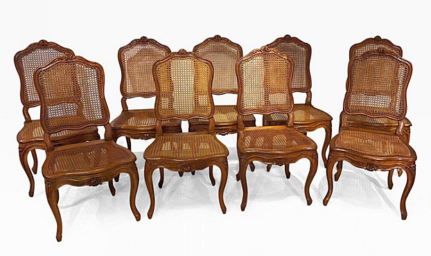 From Roger Winter Ltd, Bucks County, Penn., was this set of nine Louis XV dining chairs from the Eighteenth Century. They had carved beech wood with caned back and seat raised on cabriole legs.