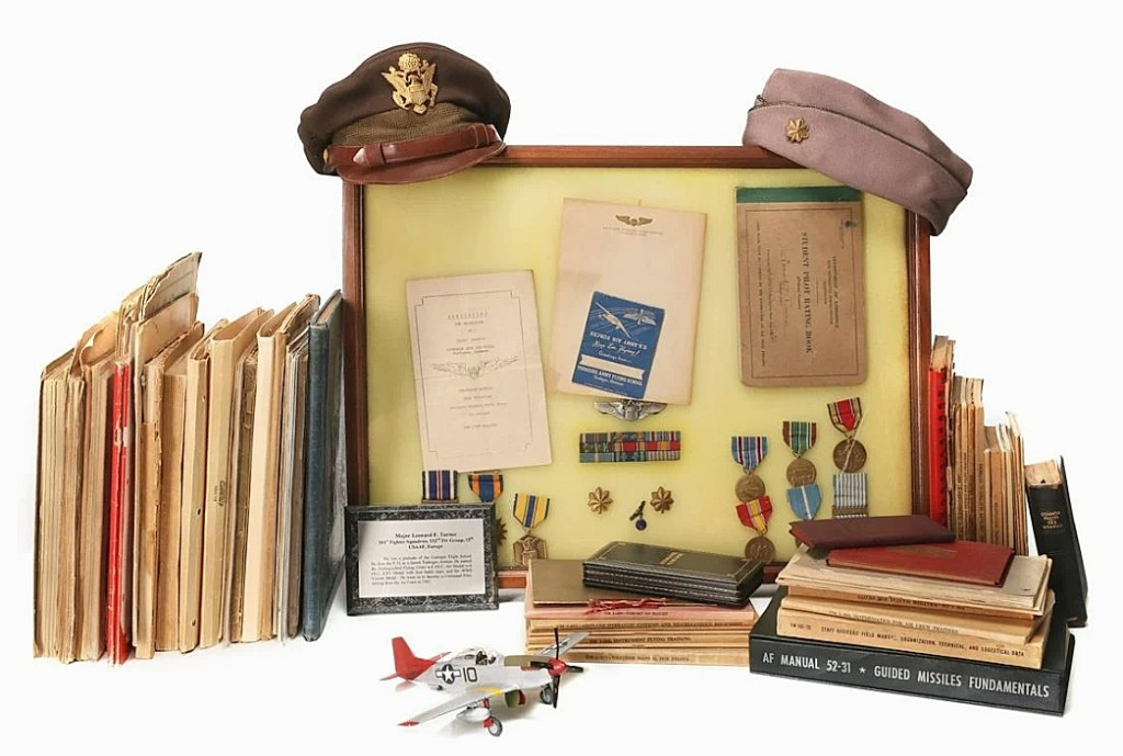 A large archive and medal assortment from Major Turner of the Tuskegee Airmen sold for $2,486. Among them were his instrument books, official personnel records, autograph books, personal ephemera and his prayer book. Earned as a P-51 pilot, Turner's medals included the Distinguished Flying Cross with four oak leaf clusters, Air Medal with four oak leaf clusters, ETO Medal with four battle stars and the WWII Victory Medal.