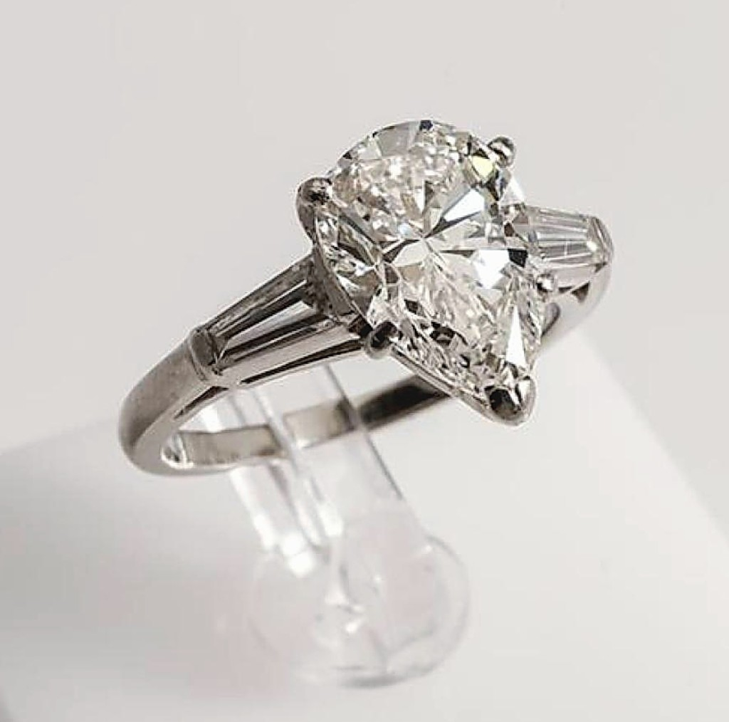 """According to Mark Weschler, """"the demand for large high-quality diamonds also remains steady."""" Leading a solid section of jewelry was a 2.26-carat diamond and platinum solitaire ring with pear-cut center stone flanked by tapered baguette-cut diamonds. The ring saw significant competition on the phones, selling within estimate for $13,420 ($10/15,000)."""