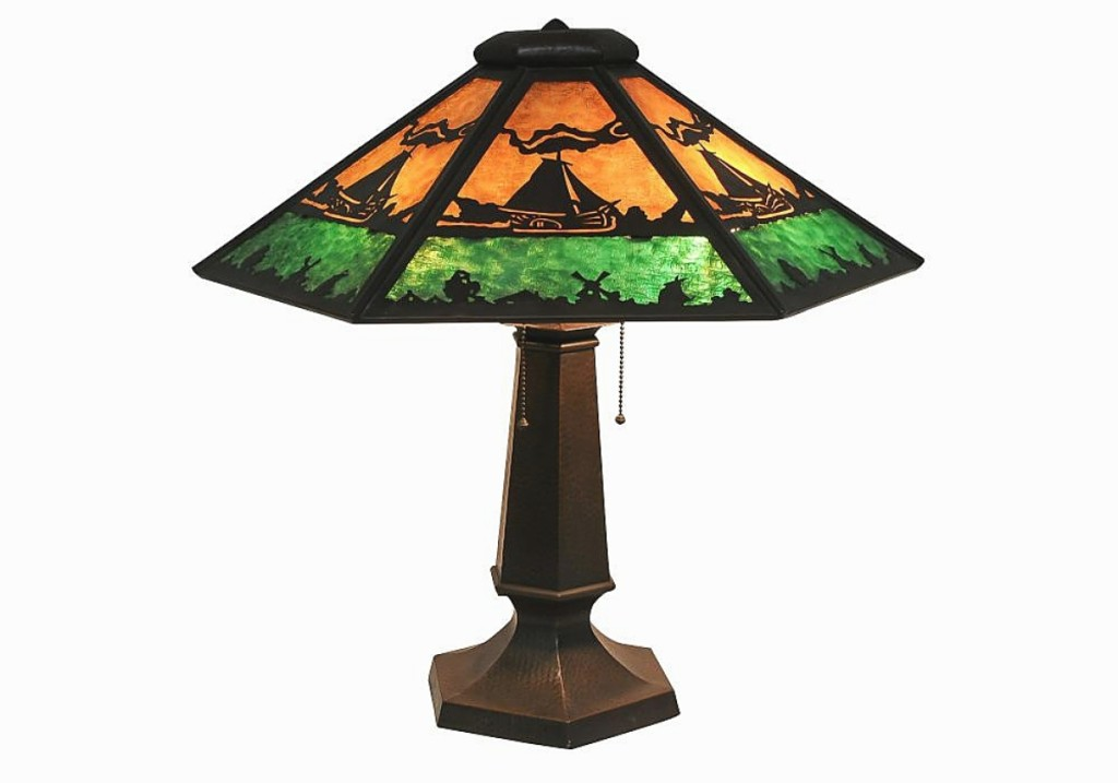 """""""It had strong interest,"""" Baratta said of this Limbert Studios hammered copper and slag glass shade with hammered copper base, the shade with sailing ships and windmills. It finished at $8,400 from an American phone bidder ($3,5/5,000)."""