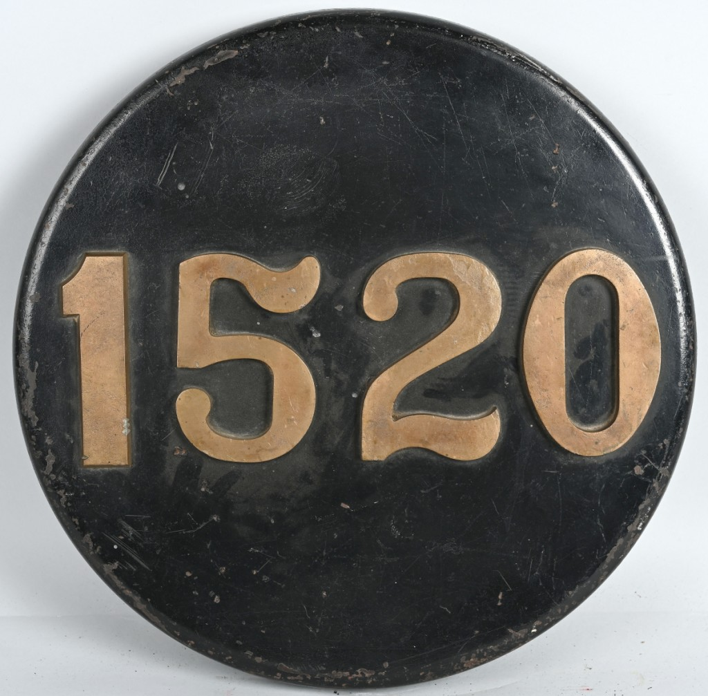 A Reading Railroad #1520, 2-8-0 camel back engine number plate from 1905 jumped its $400/700 estimate to finish $8,700.