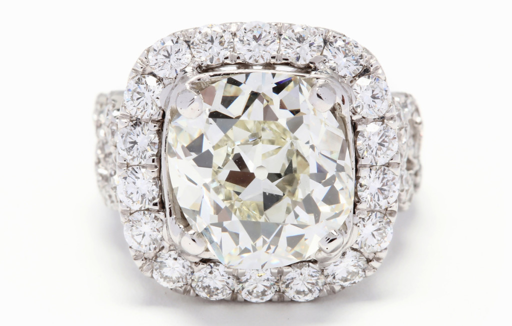 The sale's top lot, an 18K white gold and cushion brilliant cut diamond ring with a 6.20-carat center stone, finished at $44,840.