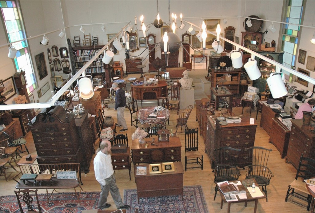 The view from the mezzanine at Nathan Liverant and Son, which maintains a large inventory of antique American furniture and accessories.