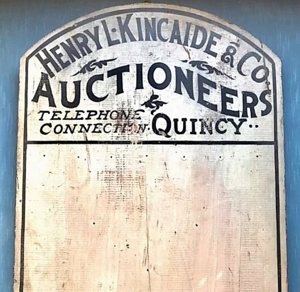 """Mark Jacobson of CapeDux Antiques specializes in folk art and nautical and local signs from old businesses, such as this circa 1910 Quincy, Mass., trade sign for """"Henry L. Kincaide And Co., Auctioneers, Telephone Conn(ection) Quincy."""""""