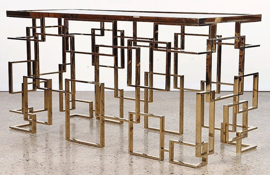 Both sales were led in value by this brass geometric console table with smoked glass that sold for $13,000. It came from a New York consignor and the auction house said it was from the 1970s.