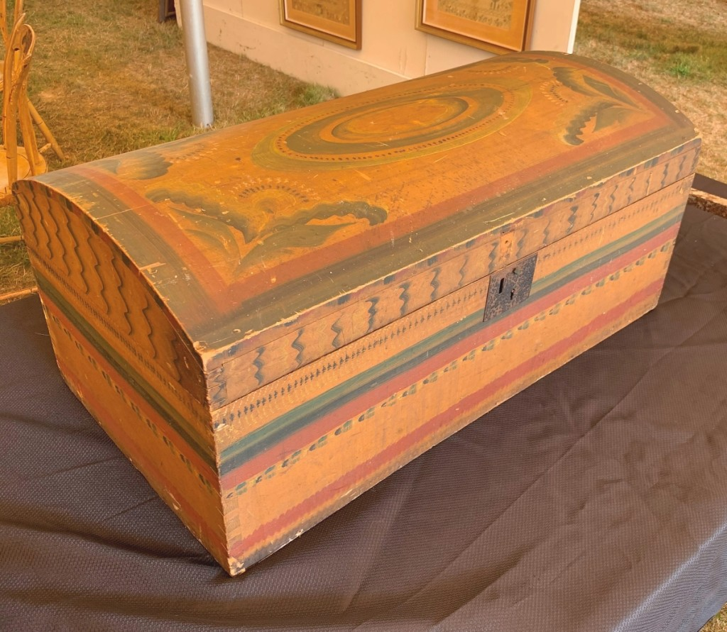 The top lot of the auction was this paint-decorated dometop trunk that sold for $7,500 to the trade. It was a lone consignment from a collector who had purchased it at an onsite Vermont auction in 1982.