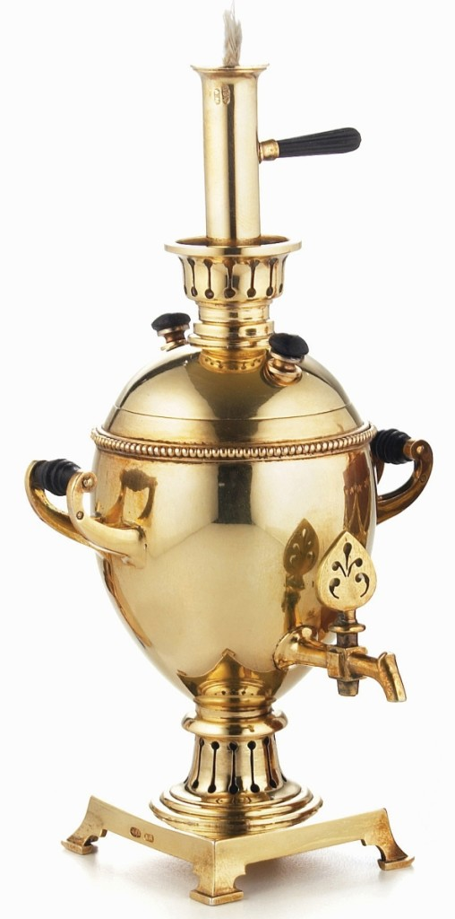 Formerly in the Forbes Collection, this table lighter in the form of a miniature samovar was made by Fabergé under the direction of workmaster Anders Nevalainen, St Petersburg, 1896-1908. Gilded-silver with ebony handles and knobs, height 4¾ inches. A La Vieille Russie.