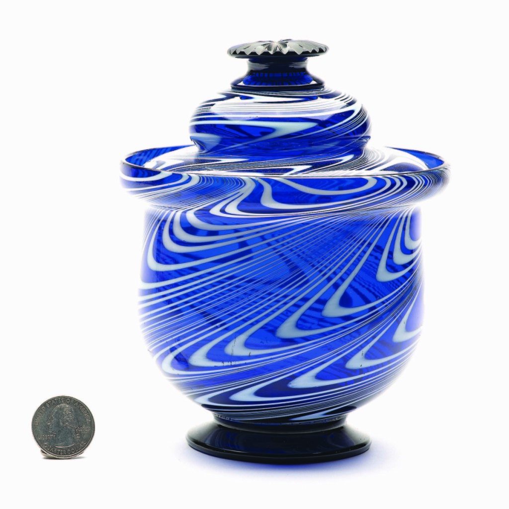 Displaying the trifecta of form, origin and color, this free-blown covered sugar bowl, probably American Midwest, 1840-60, fetched $5,558.